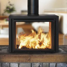 Contemporary double sided wood-burning stove STUDIO BODART & GONAY