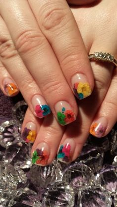 Gel Nails with real flowers....somehow these all fell apart the following week...There must be a secret.....