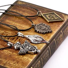 Need the perfect gift for your World of Warcraft player? 4 styles to choose from : Tribe logo, Lion's Head logo, Dwarf logo, Blood Elf logo or you can get set of 4 pendants differe Molecule Necklace, Wow World, Geek Gear, Gamer Gifts, World Of Warcraft, Leather Cord, Headbands, Cool Things To Buy, Geek Stuff