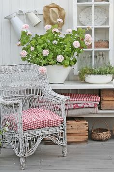 Pretty geraniums and rustic vintage fabrics...so many pretty details.
