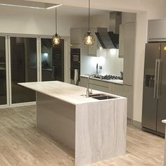 """Eminent Kitchens on Instagram: """"Annother stunning kitchen installation in a new extension project. Marmo Blanco solid surface worktop supplied by @sheridanworktop Gloss…"""" Kitchen Installation, Solid Surface, Work Tops, Apollo, Kitchen Island, Extensions, Kitchens, Tech, Mirror"""