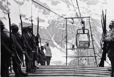 Guard of honor to a fallen transported downstream from cable car, Mount Adamello, WWI the dead was probably an officer or someone who died especially bravely, since the casualties were too many to...
