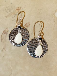 """Pretty hammered sterling silver """"full moons"""" with ancient mammoth ivory and Swarovski crystal accents. Size: 1 3/8"""" Including Hook Price: $75.00  -- on ScrimshawGallery.com #jewelry #earring #ivory"""