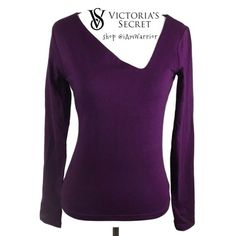 NWOT Sexy VS asymmetrical deep purple fitted top Figure flattering long sleeve purple top with sexy asymmetrical neckline, purchased through Victoria's Secret catalogue. Rich deep purple color, has shelf bra lining for bust. Top sized small but fits more like an xs. Was too small for me so never wore! Excellent condition. Moda International Tops