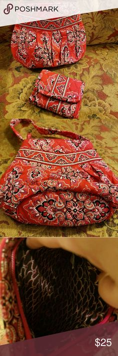 Like New 2 Piece Vera Bradley  Set Vera Bradley Mini Bag With short handle.  This is a small bag,  but honestly holds everything you need. The bag has been carried a few times,  but I'm not seeing any holes or stains on the purse.  Actually it's very vibrant and still has that new feel to it.  Great for a grab and go to the store or a smaller girl who wants a Vera Bradley like mom.   The Wallet still has tag on it.   Great colors! Black,  white,  pink,  and reds.  $95 retail for both…