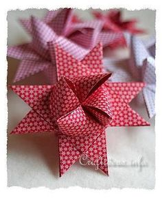handmade ornament:  ... Froebel Star - German Christmas Star ... luv the small print paper used here ...