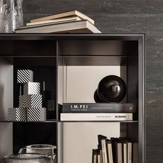 A detail of the open module, matt lacquered black, with gray mirror back panel