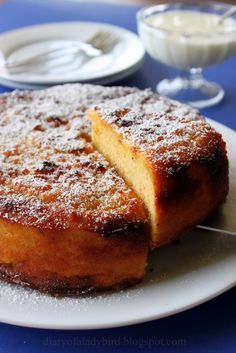 Orange, cardamom and almond cake with orange-blossom yoghurt.
