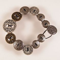"""How about making a """"button bracelet"""" out of a loved one's old shirts( for memory sake)!"""