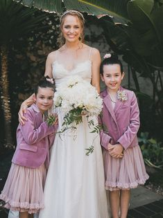 purple jacket flower girls