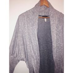 NEVER USED, light grey cardigan NEVER USED, light grey cardigan. Size small but it runs big.                                                                  Fast shipper  Accept reasonable offers  I do bundle discounts too                                 No trades Sweaters Cardigans