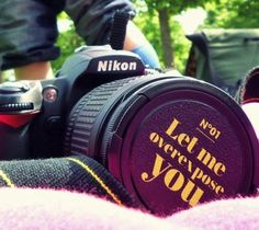 """Overexpose #Lens Cap by Objektivist with the words """"Let me overexpose you"""". The first one in the series of photographically motivated, pin-button like lens #caps. Love overexposed portraits? Front protection lens cap made of plastic material in black base-color. Side pinch for easy clipping the cap on your camera lens. UV-print, #lightly structured surface."""