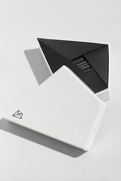 Bespoke branded white box with silver foil print and custom black interior fold out. Fully bespoke printing stationery