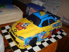 Mark Martin 2009 Nascar Cake - Mark Martin 2009 Nascar Car Cake.  Cake was a dark chocolate guinness with irish cream filling.  All cake except the wheels are RKT's.  Covered in fondant with edible images printed off for each and every sponsor sticker.  Pretty tedious but the end result was worth it.
