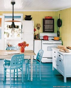 Blue Kitchen Floor, yellow walls, white cabinets, touches of red