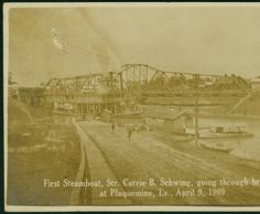 First Steamboat, Str. Carrie B. Schwing, going through bridges, at Plaquemine, La., April 9, 1909 :: LSU Libraries Postcard Collections