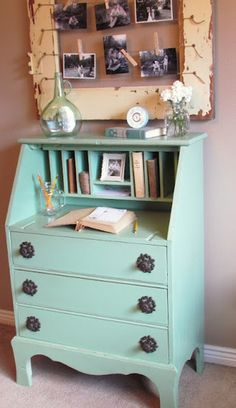 mint desk, photo display from old window frame, items displayed simply. lOve!