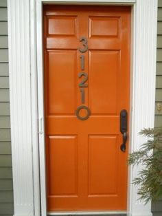 Orange door with numbers. I think I could have gone for a slightly brighter finish on the numbers, or coordinated it with the door hardware.