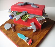 Tool box cake and cookies - This toolbox cake was a chocolate cake with a mocha-cappuccino filling. The tools are hand-decorated sugar cookies.