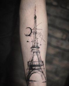 arm eiffel tower tattoo