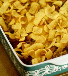 Frito Chili Pie  1 cans chili 1 8 ounce bag of Fritos 1 chopped onion 2 cups shredded cheddar  1. Preheat oven to 350 and lightly grease a 2 quart casserole  2. Layer ingredients in casserole in this order: half of the Fritos, then all of the onion, then one cup cheese, then all of the chili, then the rest of the Fritos, then the rest of the cheese.  for Will