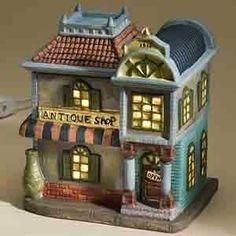 Town Village Electric Tart Burner - Antique Shop by Levine Gifts, http://www.amazon.com/dp/B002CNGY08/ref=cm_sw_r_pi_dp_dNqlrb10ADPZR