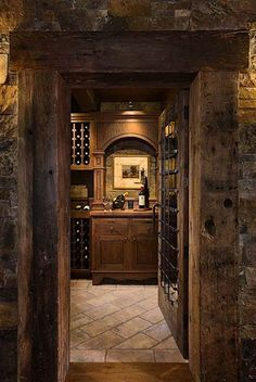 i want my whole house to look like this. dark wood, country looking. minus the wine cellar lol