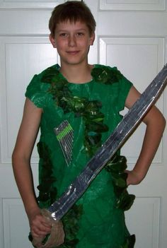 Peter Pan:  Costume made out of…  -plastic tablecloth  -Duct tape   -Plastic leaves   -straws  -green yarn   -foam board  -chicken wire  -paint stirs  -card board
