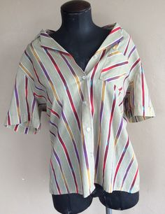 A personal favorite from my Etsy shop https://www.etsy.com/listing/227456192/1970s-blair-striped-blouse