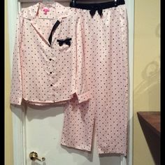 Betsey Johnson satin pajamas Satin pajama from Betsey Johnson in light pink satin with hearts/diamonds/spades/club print. Size medium. Long sleeve, full button front, notch collar top with front pocket and bow detailing. Pant features elastic waistband with bow detailing. Brand new with tags - never worn before. Betsey Johnson Intimates & Sleepwear Pajamas