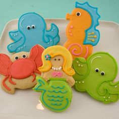 Cookies like these would make cute cake toppers for a child's cake: sugar glue them to a disc first and ice around them. Easy for beginners!  sea cookies