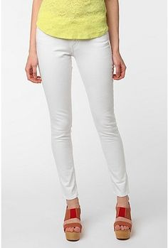 White jeans with a bold topper, and color blocked shoes. A great way to ease into the bold trend