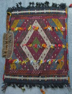 """Sivas area Kurdish tribal travel bag. Cicim weave and has leather opening at top. Some small wears on the backside. Size; 27"""" x 33"""" (69 cm x 84 cm)."""