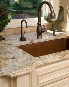 Bordeaux River Granite counter top. Like the color and oil rubbed bronze fixtures.