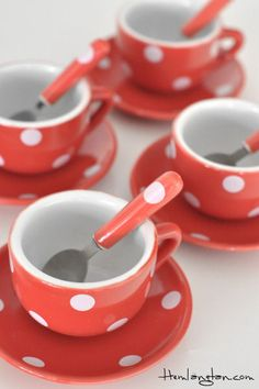 i like these cute little cups and saucers with matching spoons