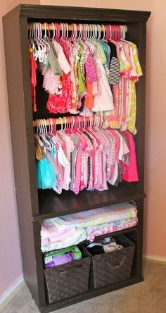 Great Nursery Hack: turn an old bookcase into a wardrobe storage with a few dowel rods. Be sure to attach to the wall for added safety!