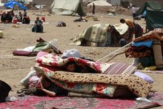 SEEKING PROTECTION: Syrian refugees waited to receive a tent at Kawergost refugee camp in Erbil, Iraq, north of Baghdad, Wednesday. (Hadi Mizban/Associated Press)