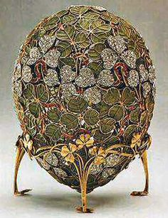 ...Clover Leaf Egg, 1902. This delicate egg is made up of an openwork of stems and clover leaves. It looks like the pattern is woven by golden threads, and the gaps between the leaves are covered with transparent bright green enamel.