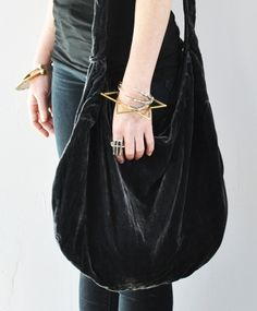velvet bag by something else. i like accessories you can pet, although i imagine the velvet would get destroyed pretty quickly.
