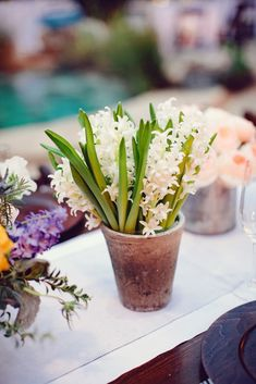 In a more #rustic #wedding theme, you may want to use galvanized pots to place flowers on tables.