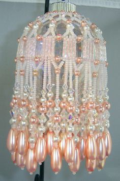 A beautifully hand beaded Victorian style Christmas ornament to become a treasured heirloom to pass down to the next generation! The soft peachy color will also be wonderful for an Easter decoration. Carefully hand crafted with attention paid to detail. This is a bead cover but we send the glass ball so you dont have to try to find one! Bead covers are great so if the ball breaks you wont loose the whole ornament. This is a one of a kind ornament! We never make two exactly alike so y...
