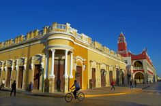 Eye-catching buildings in Independence Square in Merida, Mexico. The central plaza is a popular gathering spot for tourists and visitors alike.