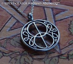 "VESICA PISCIS Glastonbury Chalice Well Cover Silver Pewter Amulet Pendant Necklace on 20"" Silver Plated Chain for Celtic Druid Avalon Magic… The symbolism behind this is really cool"