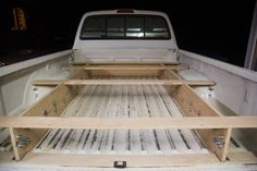 He started by cleaning out the bed of his truck and making some precise measurements. Once he had the numbers, he did a little math and cut some pieces of plywood according to his design.