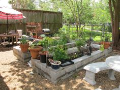 Raised Veggie Beds - Backyard herb garden designed by Laurin Lindsey, Ravenscourt Landscaping, Houston