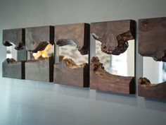"""Five live-edge wood mirror display - This DIY project is by DIY Network's """"Mega Dens team"""" for the 2014 Blog Cabin. See http://www.diynetwork.com/blog-cabin/family-room-pictures-from-blog-cabin-2014/pictures/index.html"""