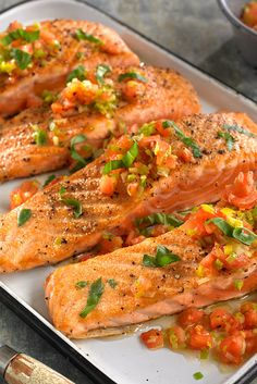 NYT Cooking: Here is a fresh and simple way to prepare salmon that is ready in about 20 minutes. Most of that time will be spent preparing the vegetables. You do have to blanch, core and chop the tomatoes, but that is quick work (and we won't tell if you use the canned, diced sort. Just drain first.). Once that's done, sauté the fish and set aside. Throw tomatoes, leeks, lemon juice and freshly ground pepper into the pan and sauté for a quick minute. Spoon over the fish and serve.