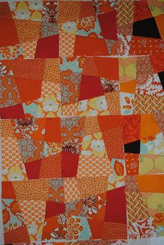 Crazy 9 Patch Blocks for a quilt  (not in their final layout).  The colour orange is so energizing!