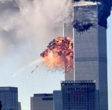 Engine and landing gear parts leave smoke trails after United Hijacked United Airlines Flight 175 from Boston crashes into the south tower of the World Trade Center and explodes at 9:03 a.m. on September 11, 2001 in New York City.