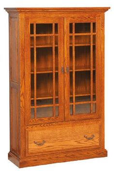 Amish Raised Panel Book Case View displayed items protected behind the gorgeous glass doors. Lots of room in the spacious lower drawer. Rich, raised panels enhance the look. Custom made for office. Choose wood, finish and hardware. #bookcase #bookcases #officestorage